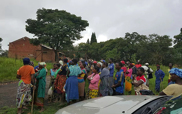 Outside the farm at the centre of the controversy is about 140 miles north of Zimbabwe's capital, Harare