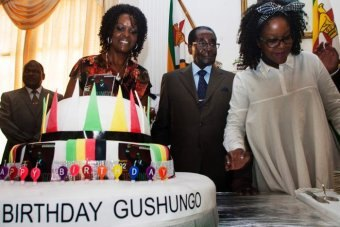 """President Robert Mugabe and his wife Grace at his """"surprise"""" birthday party at State house"""