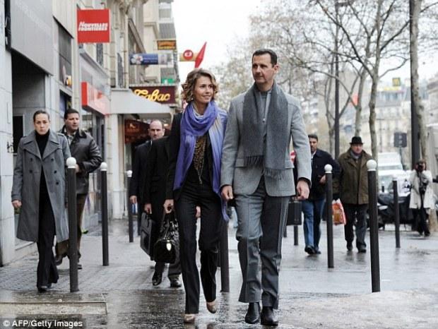 122e2dab000005dc-3524255-syrian_president_bashar_al_assad_and_his_wife_asma_walk_through_-a-32_14598602859721
