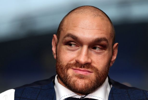 tyson-fury-speaks-at-a-press-conference-at-the-macron-stadium