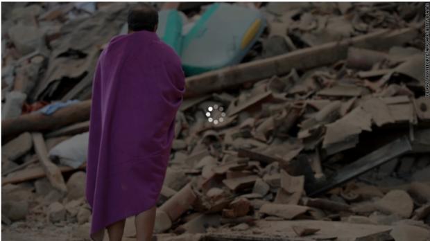 Italian earthquake 24:A victim surveys the quake debris.png