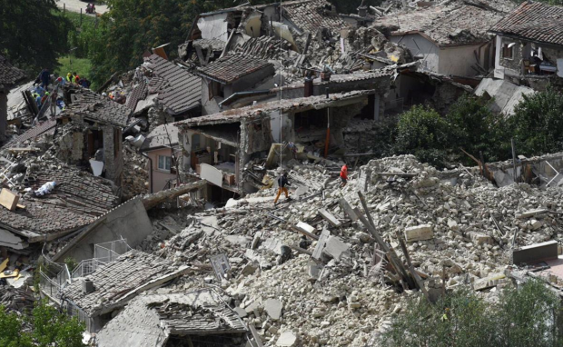 Italian Earthquake13: Rescuers are seen working in the rubble of collapsed and damaged houses in the village of Pescara del Tronto, central Italy