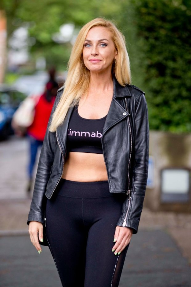 EXCLUSIVE: Big Brother winner Josie Gibson bares her midriff outside a London clinic.