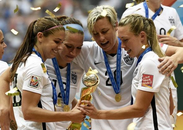Alex Morgan, Lauren Holiday, Abby Wambach, and Whitney Engen celebrate their World Cup title, won't face questions about their femininity.*