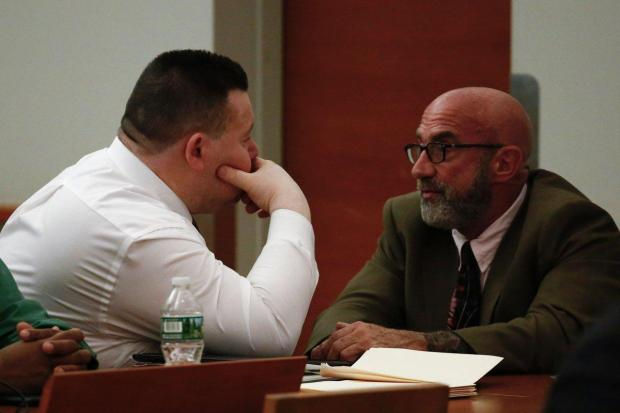 defence-attorney-feldman-r-speaks-with-his-client-chief-eliseo-perez-l-in-court1