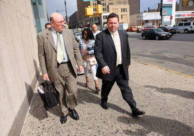 former-rikers-island-chief-eliseo-perez-jr-right-a-jail-captain-exits-the-bronx-hall-of-justice1