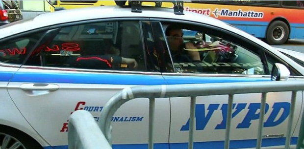 NY subway pushing death suspect in police cruiser.png