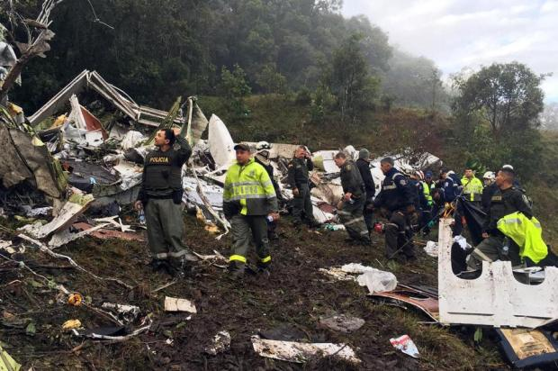 Rescue workers scour the crash site of the air columbian disaster.jpg