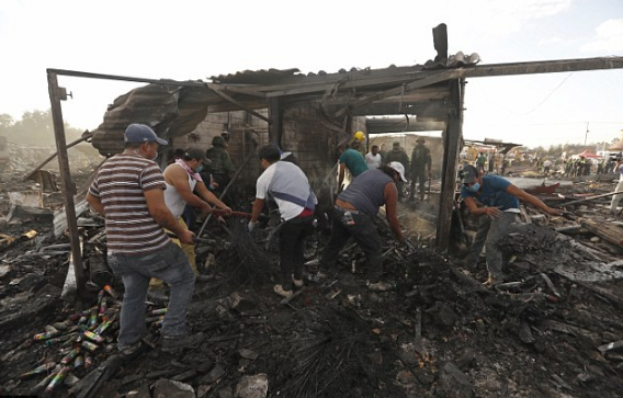 residents-combed-through-the-ashes-and3-the-rubble-after-an-explosion-ripped-through-the-market