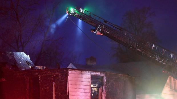 Firefighters search for six children presumed dead after an early morning fire in the Malone home2.jpg
