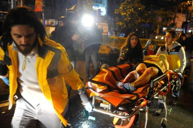 Paramedics lift injured patron after the Istanbul nightclub shooting1.jpg