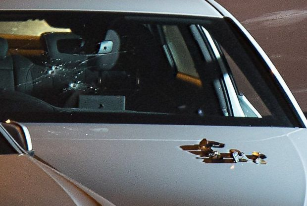 Three bullet holes in the windscreen of a white Audi2.jpg