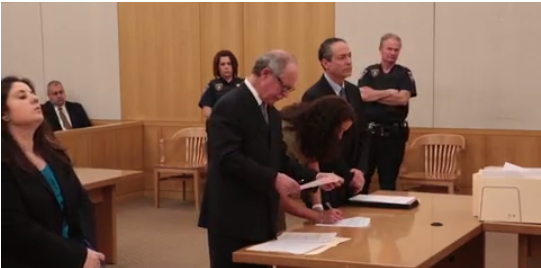 Emily Darden signs her plea agreement in court.png