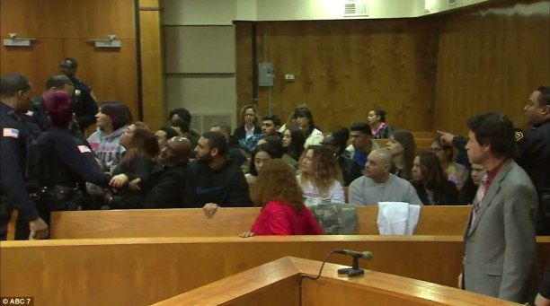 Families brawl: As Thomas was led out of the court room, a family member of one of the victims was seen yelling at another woman across the room1