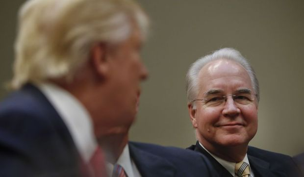 Health and Human Services Secretary Tom Price [Right], listens as Trump speaks.jpg