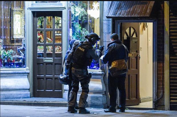 Men of Scotland yard senn outside the terror suspect's home on Hagley Road in Birmingham on wednesday night.png