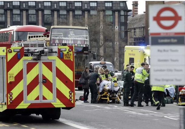 Paramedics wheel away a victim on Westminster Bridge. A doctor at St Thomas' hospital said some have catastrophic injuries.png