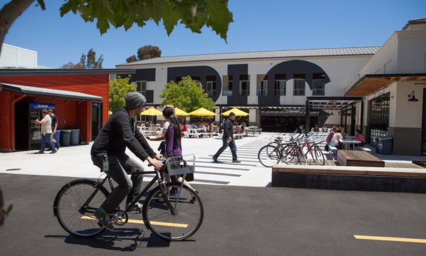 people-cycle-and-stroll-through-facebooks-main-campus-in-menlo-park-california
