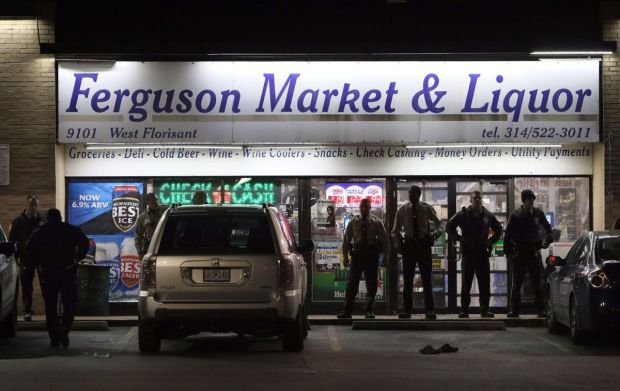 Police stand guard at Ferguson Market where Michael Brown visited before being shot to death in 2014