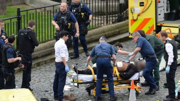 The alleged attacker was taken to a waiting ambulance on a stretcher