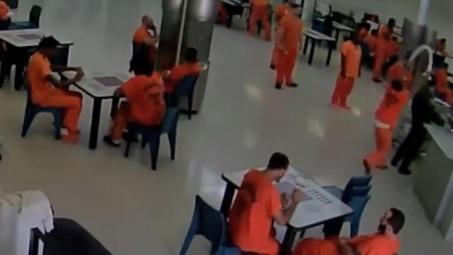 The inmate approaches the guard from behind and throws a towel around his neck.jpg