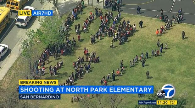 Children gather outside North Park Elementary School, Monday after the shooting inside a classroom