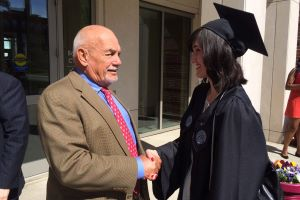 Honorary degree recipient Robert Foisie is greeted by Foisie Scholar Natasa Trkulja during the 2014 graduation at WPI.jpg