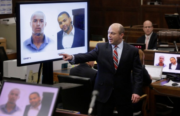 images of murder victims Safiro Furtado, top left, and Daniel de Abreu, top right, are projected on a screen at Suffolk Superior Court.jpg