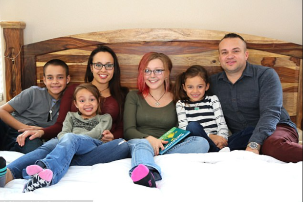 Left to right: Son Isaiah, 11, daughter Brianna, six, mother Cristina, 31,  Sierra, daughter Rebecca, seven, and dad Benno, 37, in bed at home in Austin, TX.png