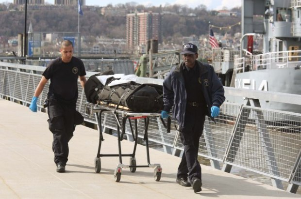 Medical examiners remove Abdus-Salaam's body..jpg