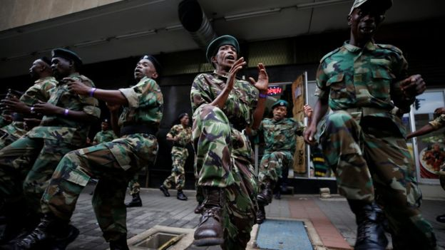 Supporters of the ANC have been singing outside the party's headquarters in support of Mr Zuma.jpg