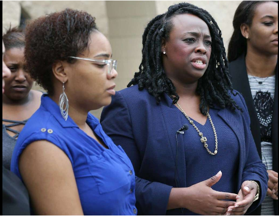 Artessia House, right, a civil rights lawyer, speaks for the mother, left, of the 14-year-old girl .png