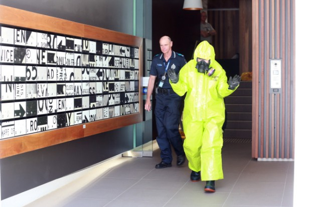 Forensics police team in hazmat suits had to be hosed down after they left the scene of the gruesome crime1.jpg