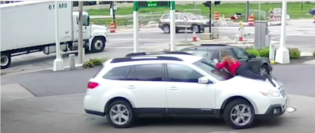 He decides to drive off with the car he was stealing, mindless of the vehicle owner now sprawled on the hood.png