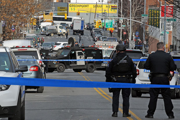 NYPD officer cordon area around condo complex,  the scene of the standoff with Gene Barrett, in Brooklyn, NY on March 6.jpg