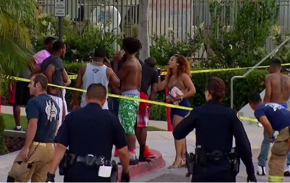 Panic and disbelief among the poolside partygoers after Grief stricken poolside party goers after seven people were shot by gunman.png