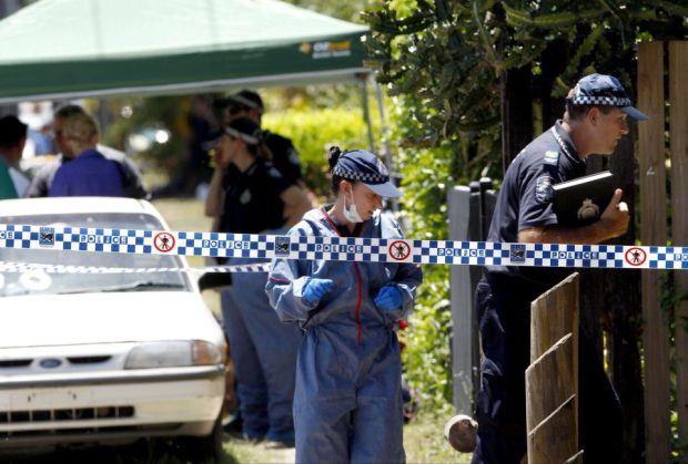 Police and EMTs investigate the crime scene where Thaiday murdered 8 children in Queensland, Australia in Dec 2014