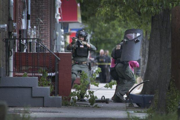 Police remove a woman from nexr door.jpg