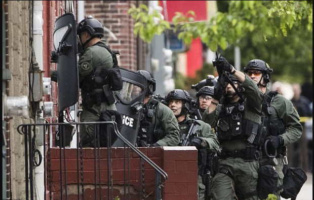 Riot police establish operational base next door to where Reese has barricaded himself in NJ Wednesday.png