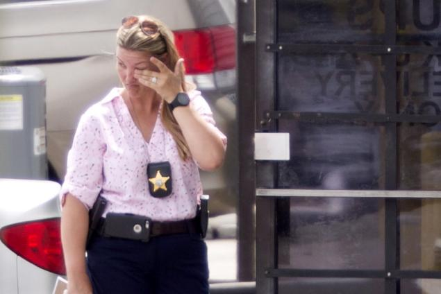 A law enforcement official wipes her eyes at the entrance to the shooting crime scene in Orlando, Florida on June 5, 2017