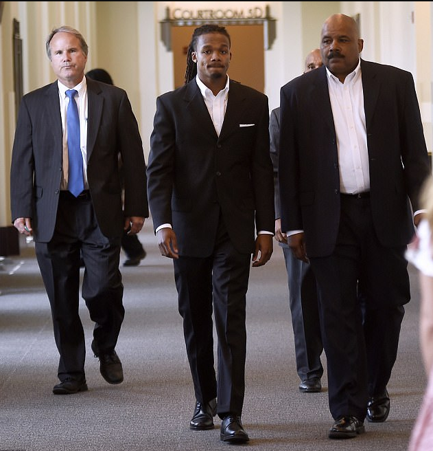 Brandon Banks  and his father, Maurice Banks (right) and one of his attorneys, Mark Scruggs, in court.png