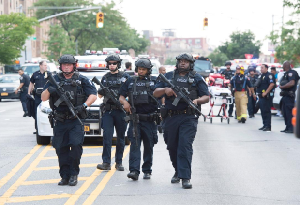 Heavily armed police on the scene.png