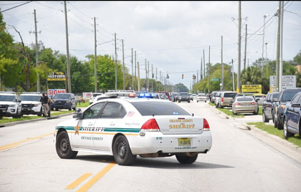 Law enforcement authorities blocked off the streetrerouting traffic around the area.png