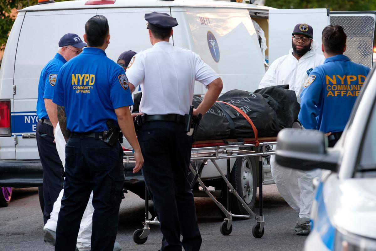 Medical Examiner's staff removing the body, Friday.jpg