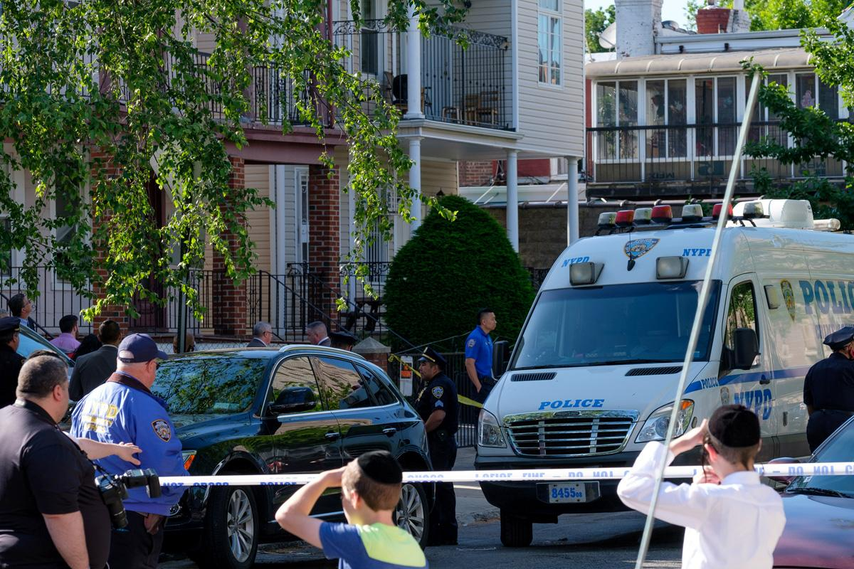 Police investigating the scene after a body was discovered inside a closet at the 466 E. 2nd St. home in Brooklyn.jpg