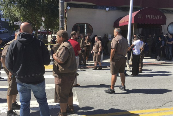 UPS staffers outside the warehouse and customer service center in San Francisco on Wednesday after the shooting2.png