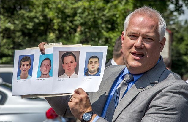 Bucks County District Attorney Matthew Weintraub holds up photos of four men who 2.png