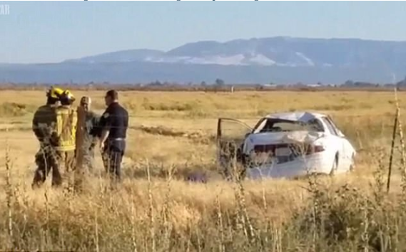 The car rolled over a barbed wire fence and onto a field inLos Banos, friday.png