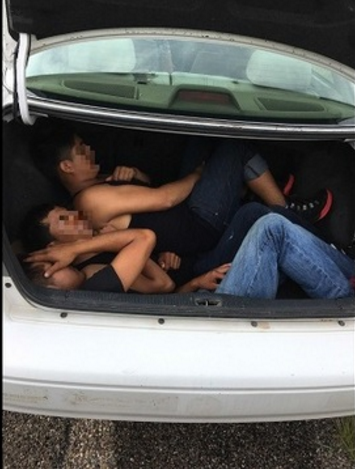 Image result for men smuggling in toyota camry