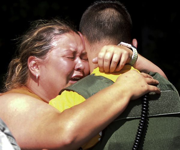 Brooke Bohanan embraces forest Ranger Les Kwiatkowski after learning her stepson, Austin Bohanan, walked out of the park Tuesday Aug. 22, 2017, 11 days .jpg